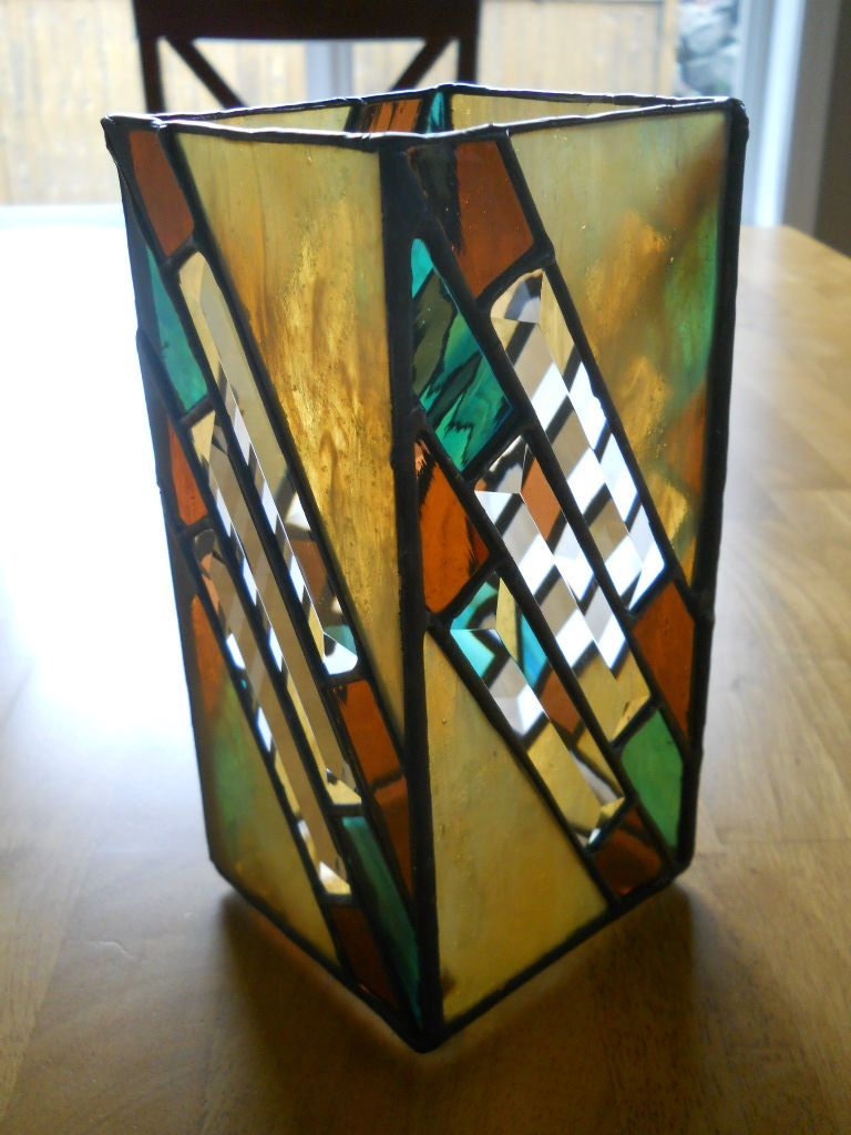 Buying your mom flowers for mothers day then put them in a stained glass vase made by american - Glass art by artis ...