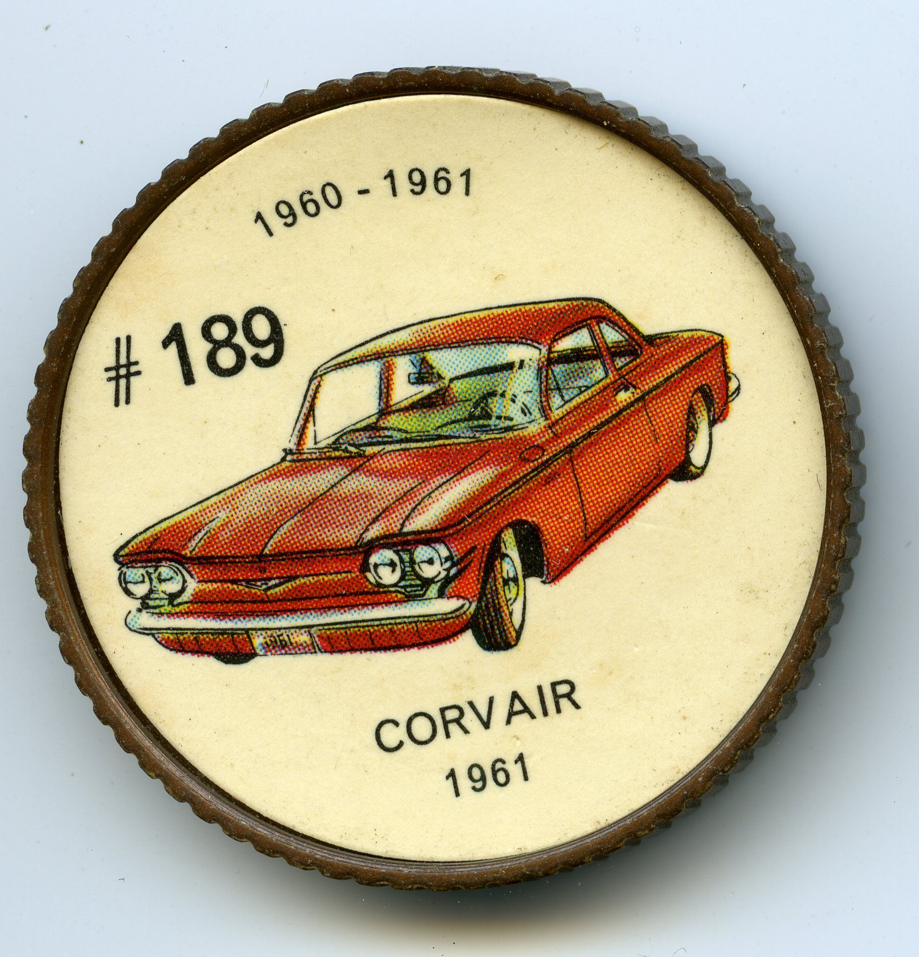 Jello-O Coin 189 - Corvair (1961) - With the Corvair, General Motors won the distinction of producing the only rear engine car in North America. This design provided good traction in snow and eliminated the space-consuming driveshaft tunnel. The flat, six-cylinder, air-cooled engine produced 80 horse power. More luggage space was provided in 1961 by moving the spare wheel to the engine compartment.