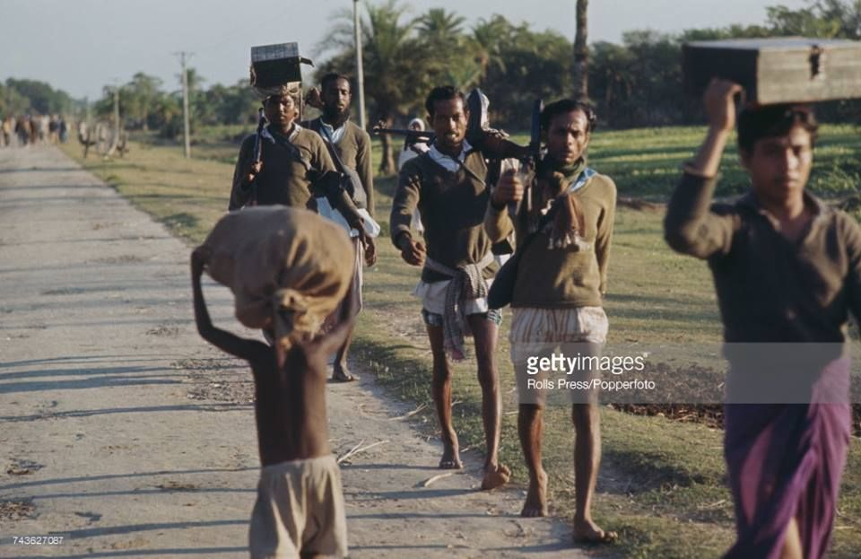 Muktijoddhas Freedom Fighters Are Walking With Their Guns During The Liberation War Of Bangladesh Freedom Fighters Fighter Bangladesh