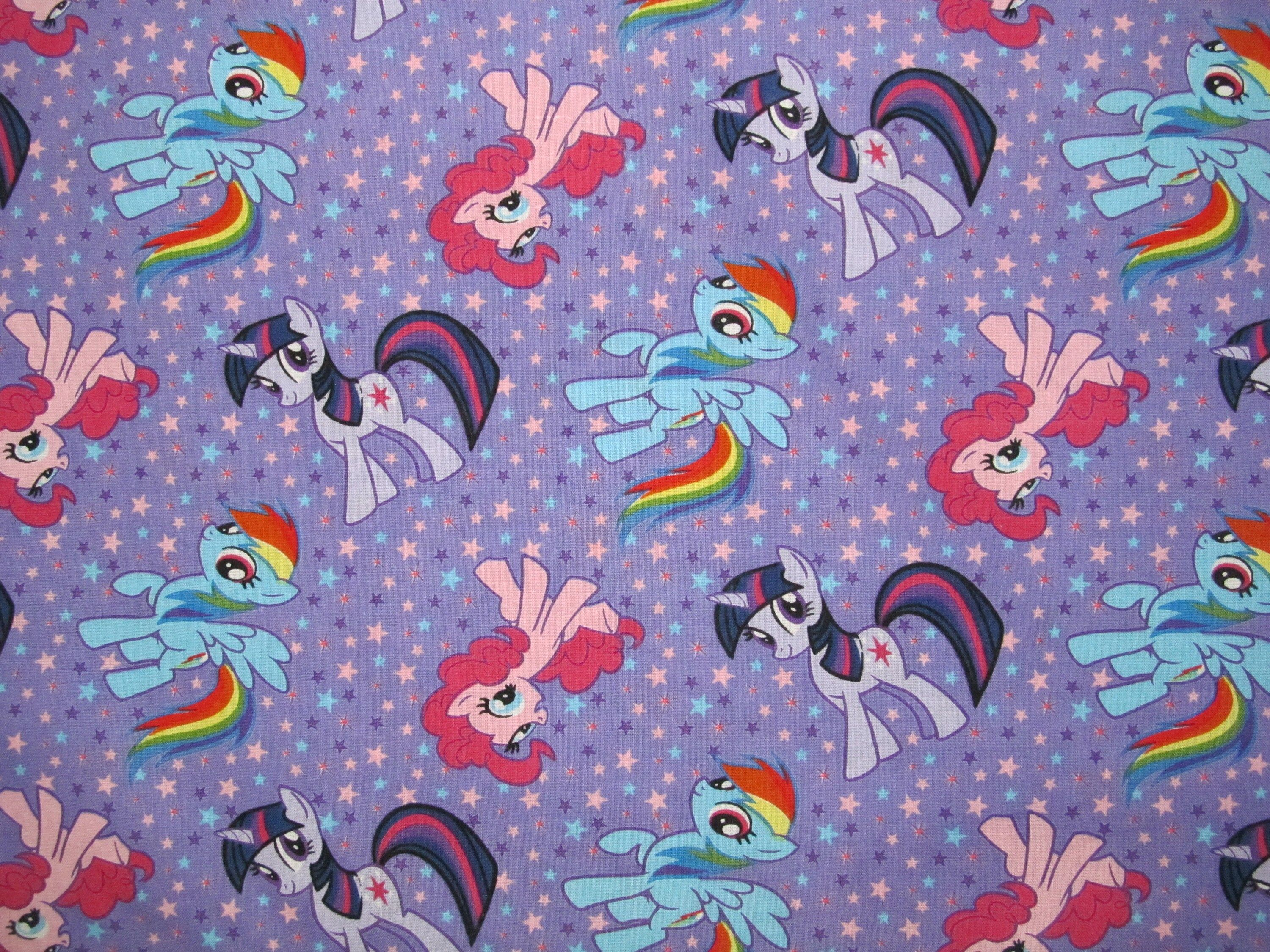 """""""**Cotton fabric** For sale is 1 yard + 30 inches of cotton fabric with My Little Pony printed on it. This fabric has an adorable design that features pictures of some of your favorite My Little Pony's with stars all over it. The background is purple. It is an awesome fabric that you or your little one will just love! It's perfect for making a quilt, pillow case, purse, clothes... whatever your crafty mind can come up with :) Fabric will be in one continuous piece. The fabric is approx 44\"""" wide"""
