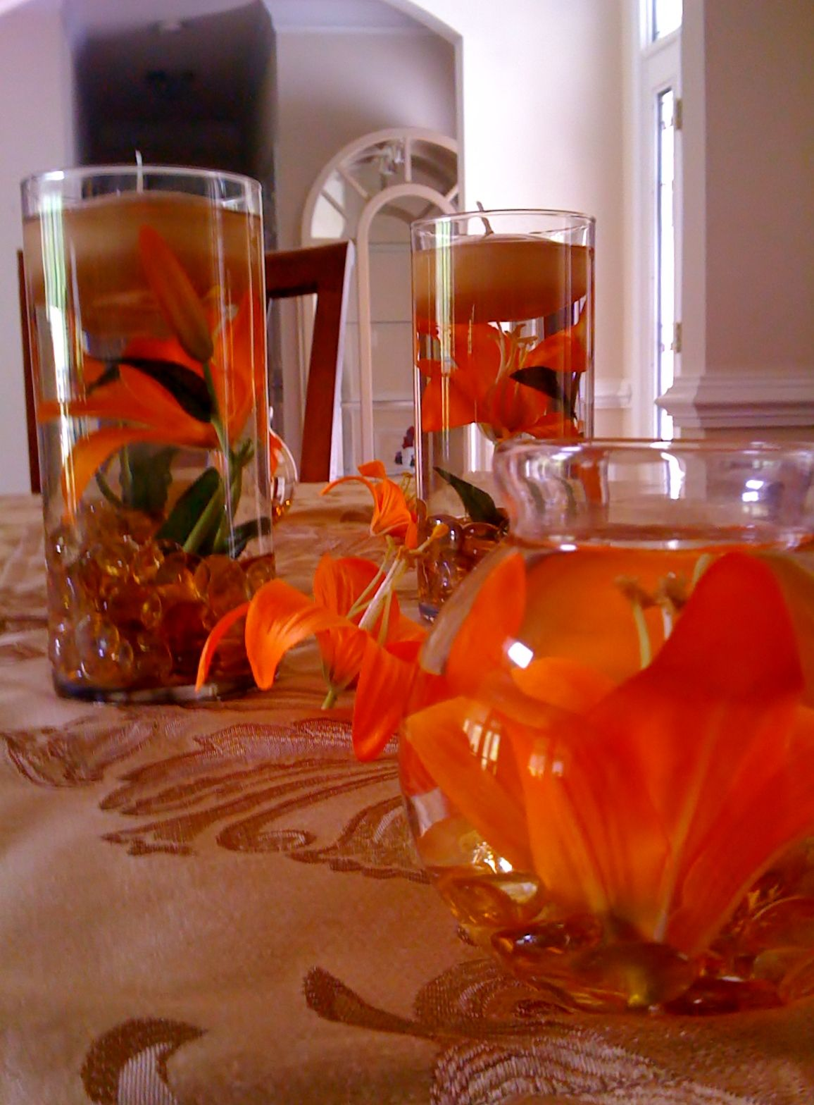 Centerpieces made with cylinder vases silk tiger