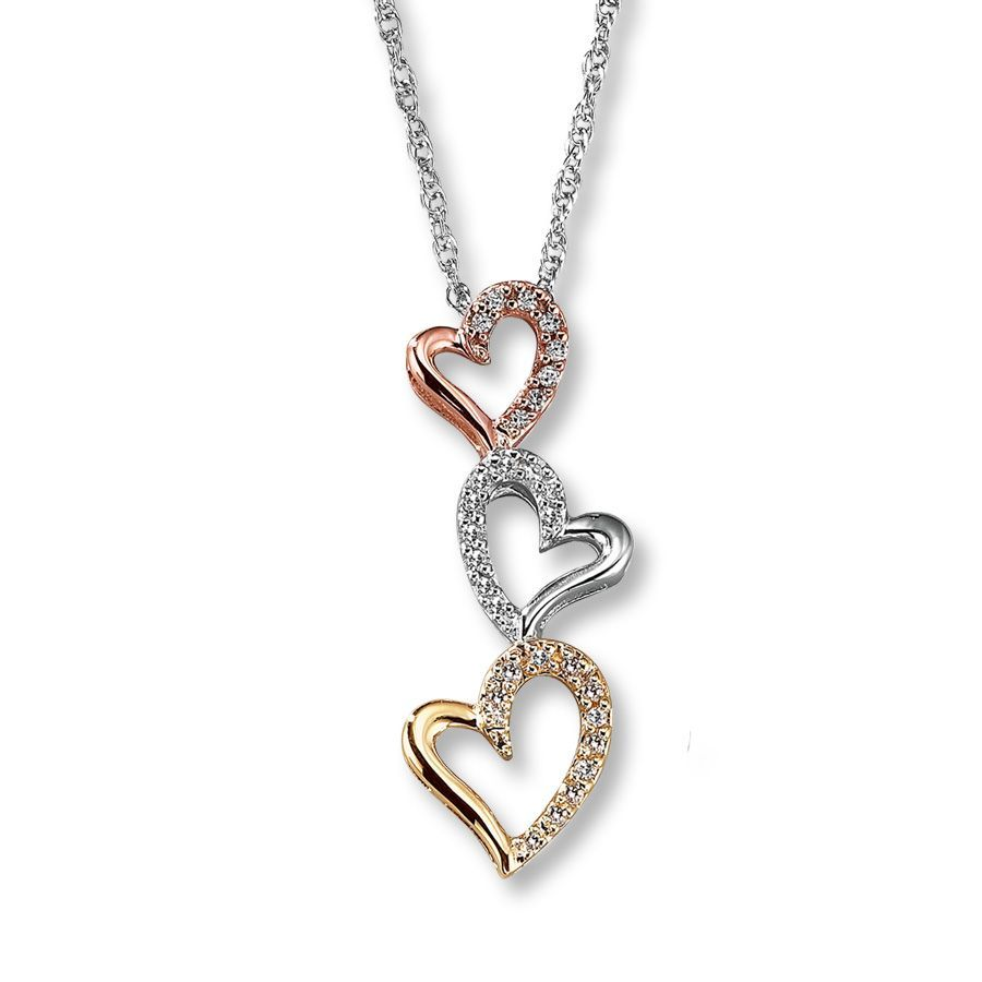 30fcc22f9f03c A trio of sterling silver hearts embellished with round diamonds cascades  from this playful necklace for
