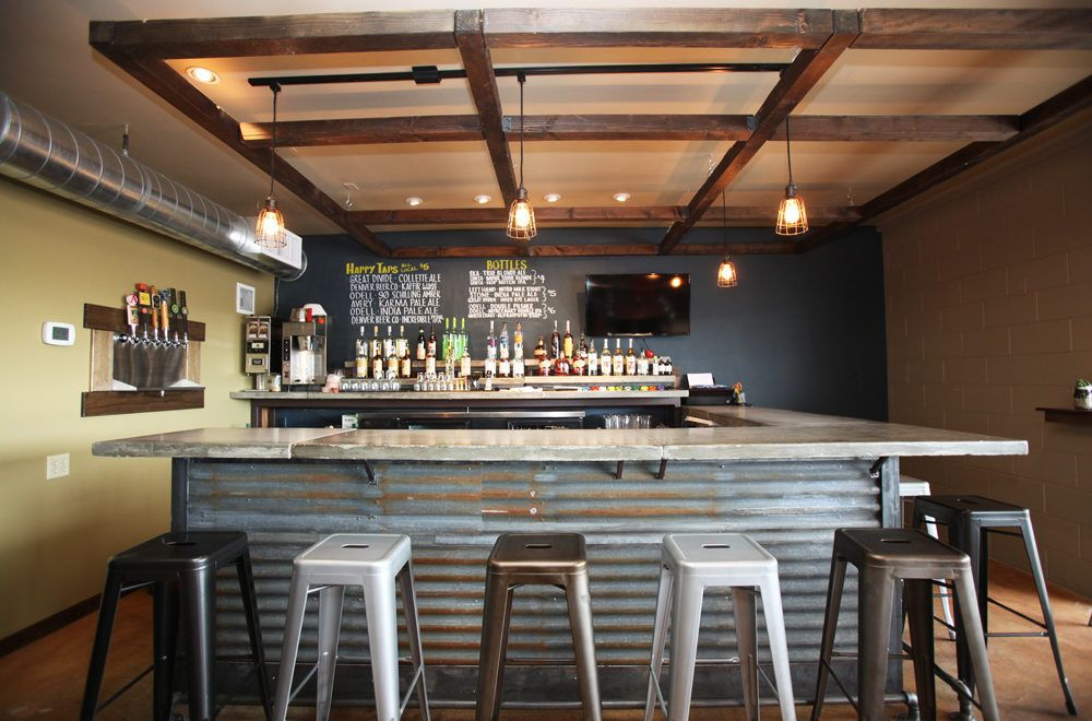 Rustic corrugated steel bar with industrial stools reclaimed