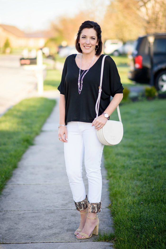 08550e1e3a8 She styled them with her white jeans and a cute black blouse. Our Kuhfs  elevate this look instantly.