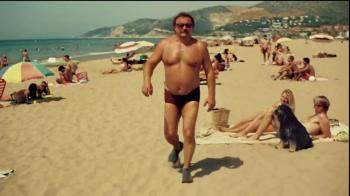 In This Commercial A Slightly Overweight Man In A Speedo Man