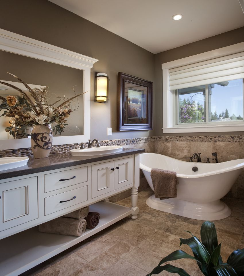 Winlock Parade Home Master Bath Spa Like Bathroom With Pedistal Tub And Furniture Piece Vanity By New Tradition Homes