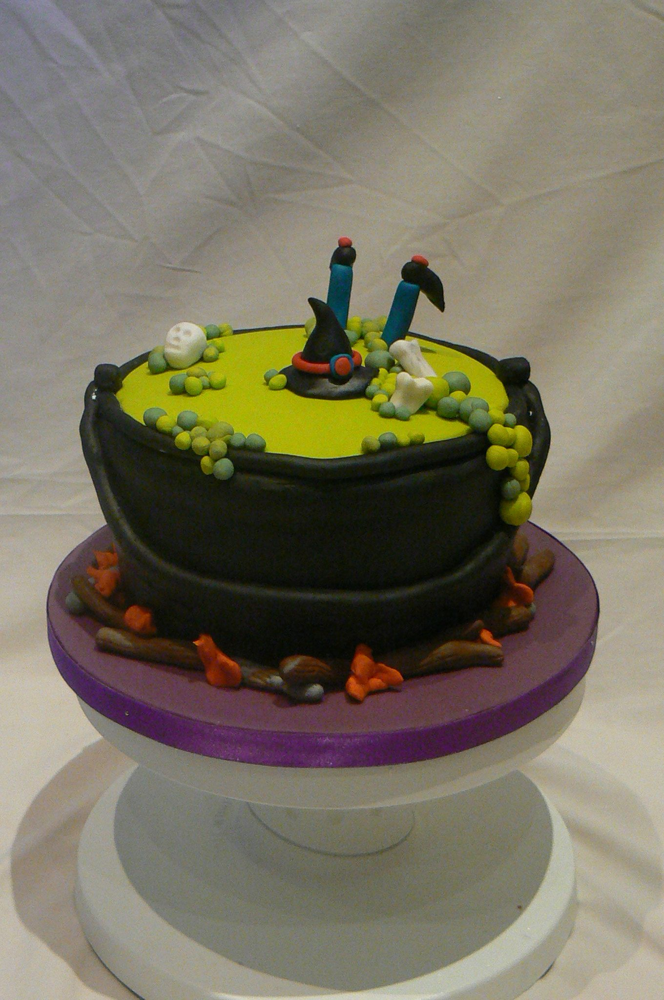 Homemade Halloween cake. Witch cake. Cauldron cake. Fun