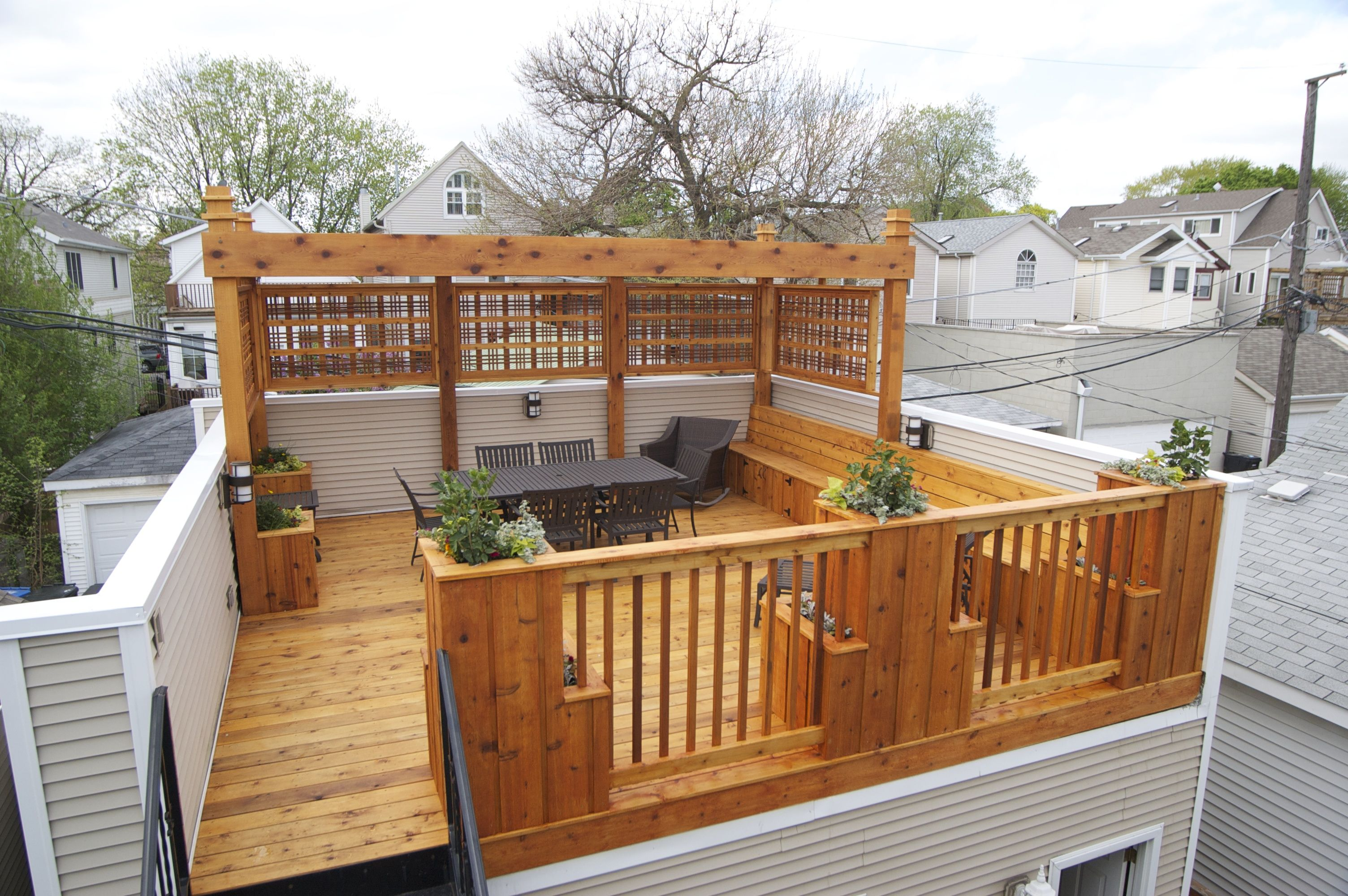 cedar pergola deck and planters design and build by punch