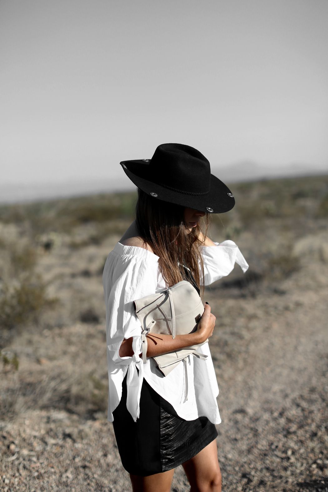 THE TRANS PECOS DESERT | Fiona from thedashingrider.com wears a white White Off Shoulder Blouse, a Black Studded Leather Skirt from Ikks, a Western Hat from Mango and Loeffler Randall Espadrilles #ootd #whatiwore #petite #texas