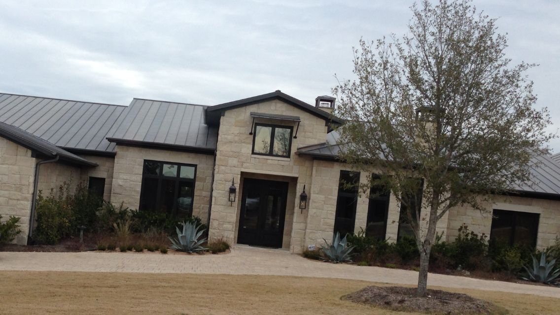 Matching Gray Leuder Rock Stone On Home Dark Metal Roof Austin Texas Exterior Stone Austin Stone Exterior Lake Houses Exterior