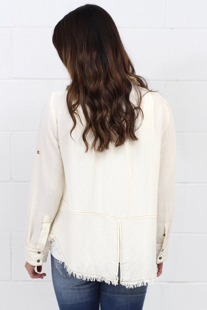 Split Back + Frayed Hem Button Down {Cream} Long sleeve button down top that can be rolled and tabbed into three quarter sleeves. Split back detail. Frayed hemline. Buttons are hidden in the front when buttoned. Looks cute as a blouse or as a jacket.