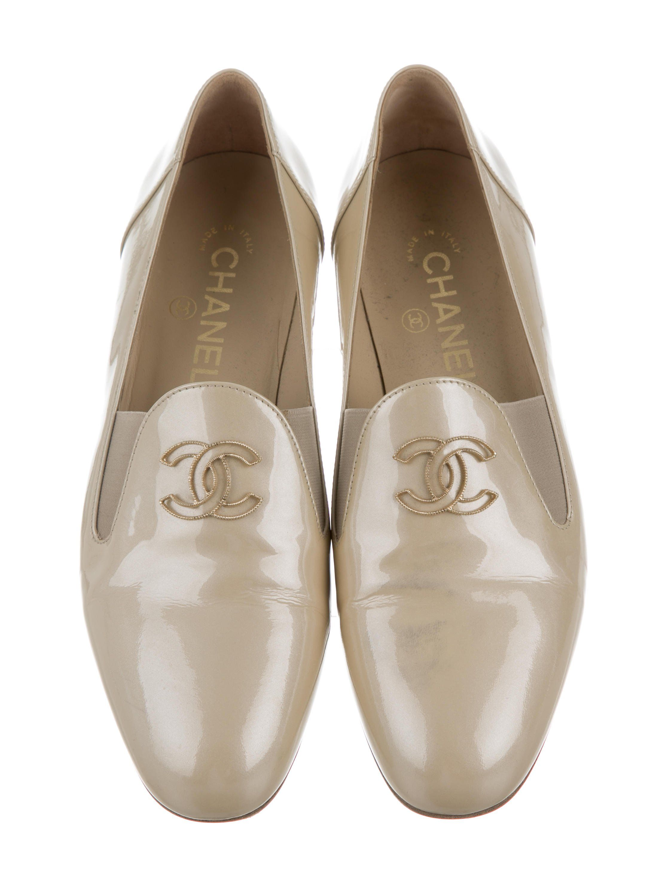0f74654a07a Champagne metallic patent leather Chanel round-toe loafers with gold-tone  interlocking CC embellishments at uppers