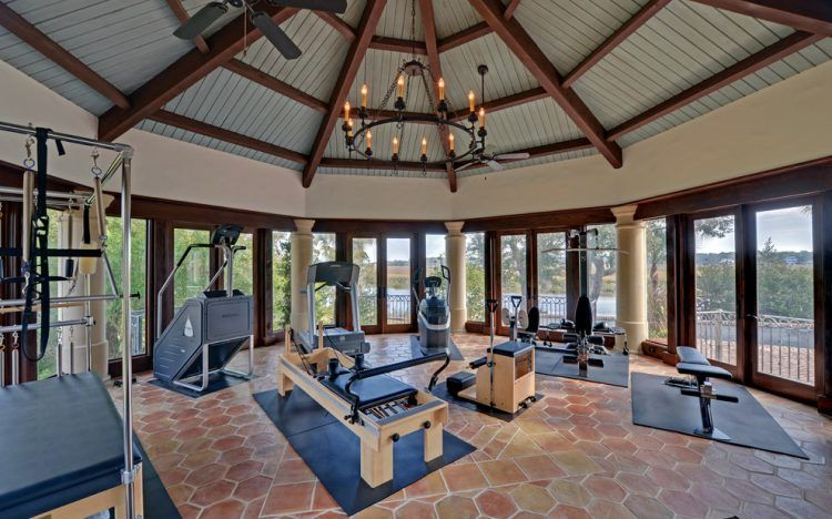 Quite Functional Sunroom Gym With A Bunch Of Cool Exercise Machines Sunroom Designs Home Gym Design Sunroom Decorating