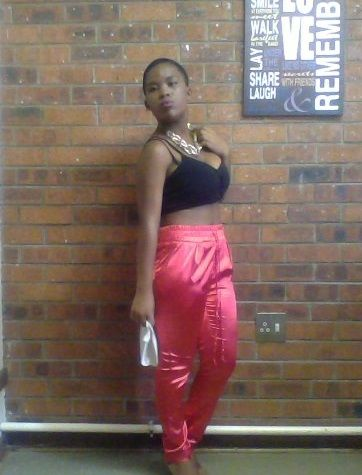 rocking the Orange silk pants and a black bralet and chunky chain.....