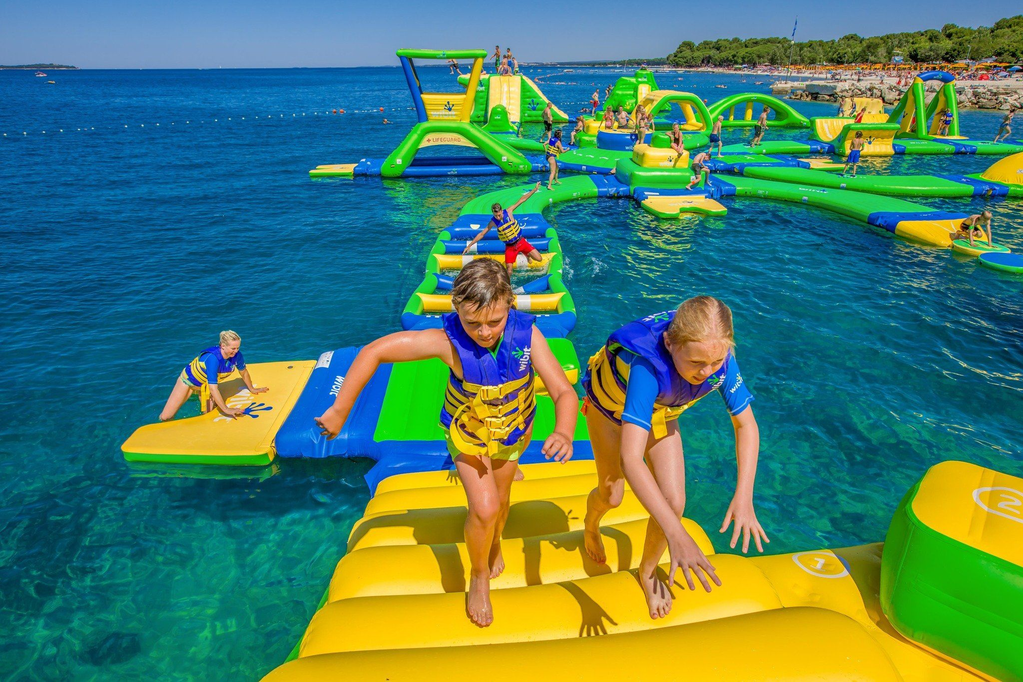 Floating Water Parks Coming To 3 Michigan Lakes Memorial Day Weekend Michigan State Parks Water Playground Water Park