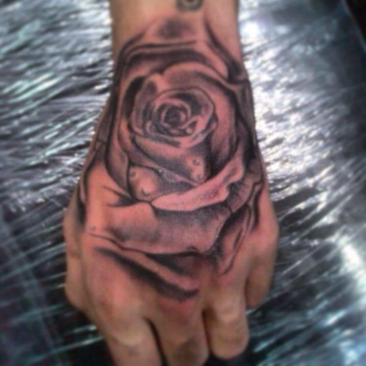 rose rosa tattoo blackgrey hand
