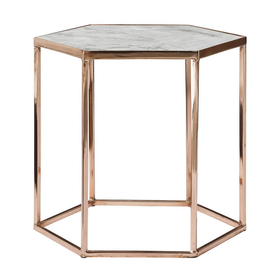 A Copper Plated Hexagonal Coffee Table With A Marble Top.The Clever  Combination Of