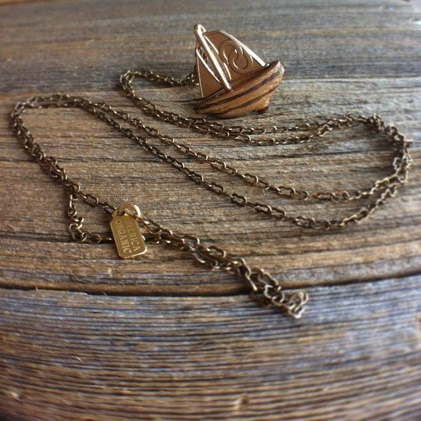 Our Sail Boat Pendant in Bronze & Zebrawood! #omericaorganic #woodjewelry #madeindenver