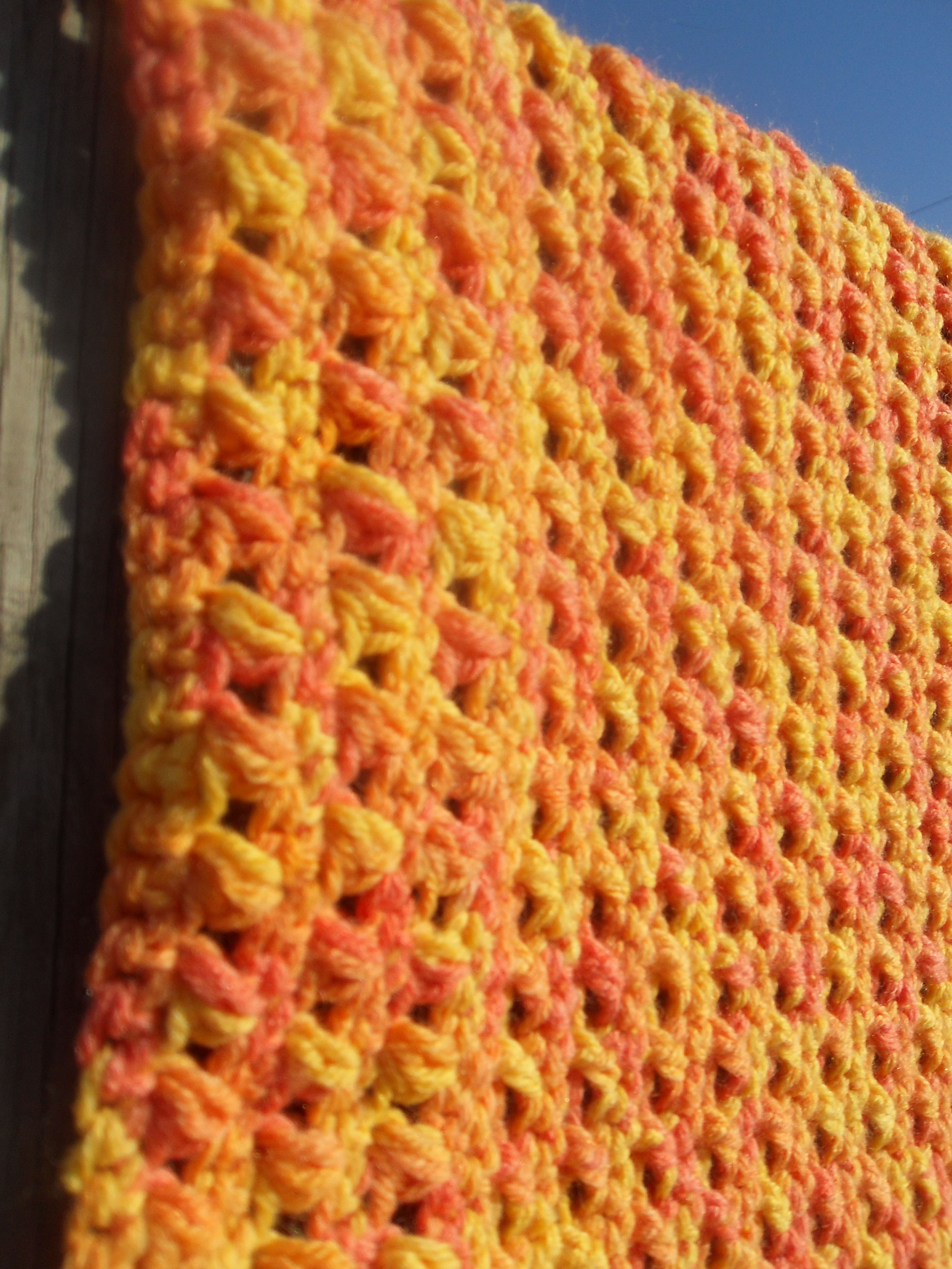 Agrumi baby blanket, puff and cross stitches