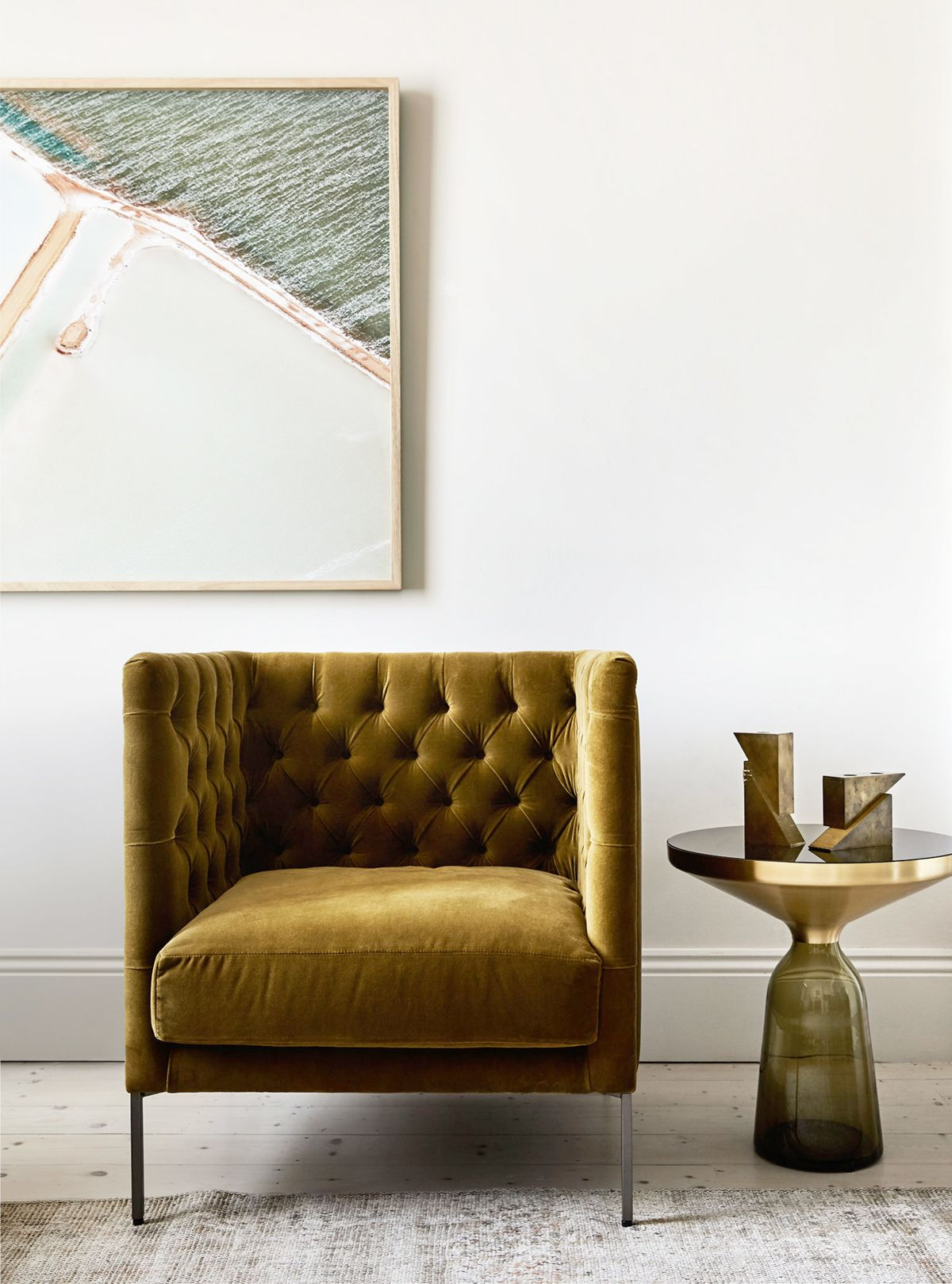 Vintage gold velvet tufted chair in the living room a sophisticated modern house tour on coco kelley