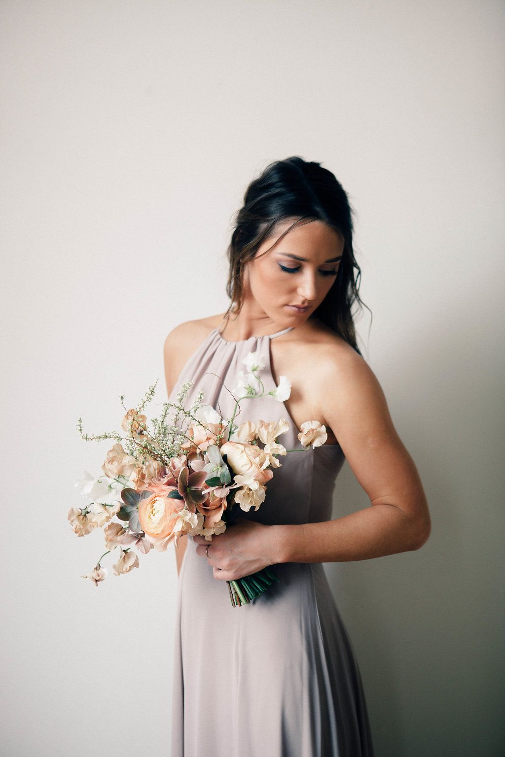 An indoor modern spring wedding in a delicate soft colour