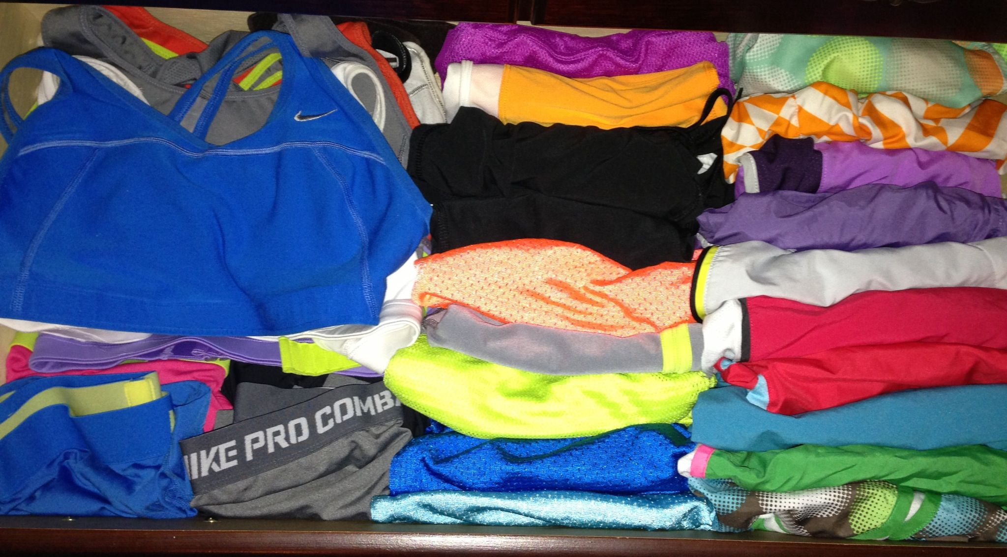 Roll shorts up to fit more in drawer and easier to see. Workout, Nike, workout clothes, fitness.