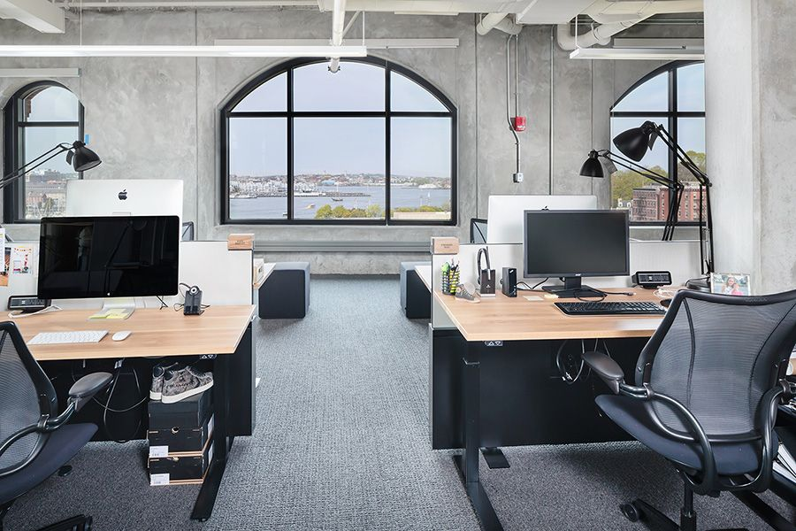 Open Office Space Design In A Former Industrial Building Features Concrete Columns And Large Windows W Office Space Design Open Office Layout Open Space Office