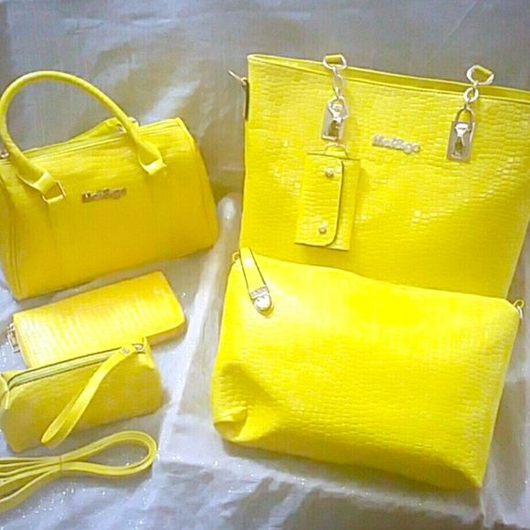 New Beautiful PU Leather Handbag Set Beautiful set come with large satchel style bag, large shoulder bag, wristlet,  small satchel,  detachable  key holder that holds several kings separately and a wallet. Lovely and live yellow color that will bring some spring into your wardrobe. This will not last long get it while available. Crocodile print. All smaller bags fit in the main bag for storage does come with a dust cover. Bags Shoulder Bags