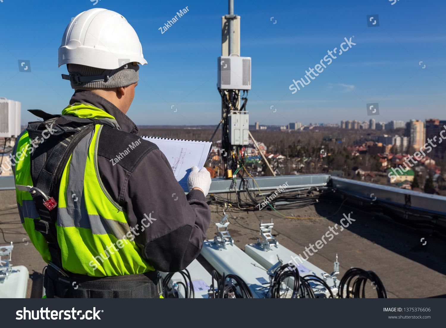 Professional Industrial Climber In Helmet And Uniform Reads Technical Documentation And Antennas Of Gsm Dcs Umts In 2020 Climbers Stock Photos Technical Documentation