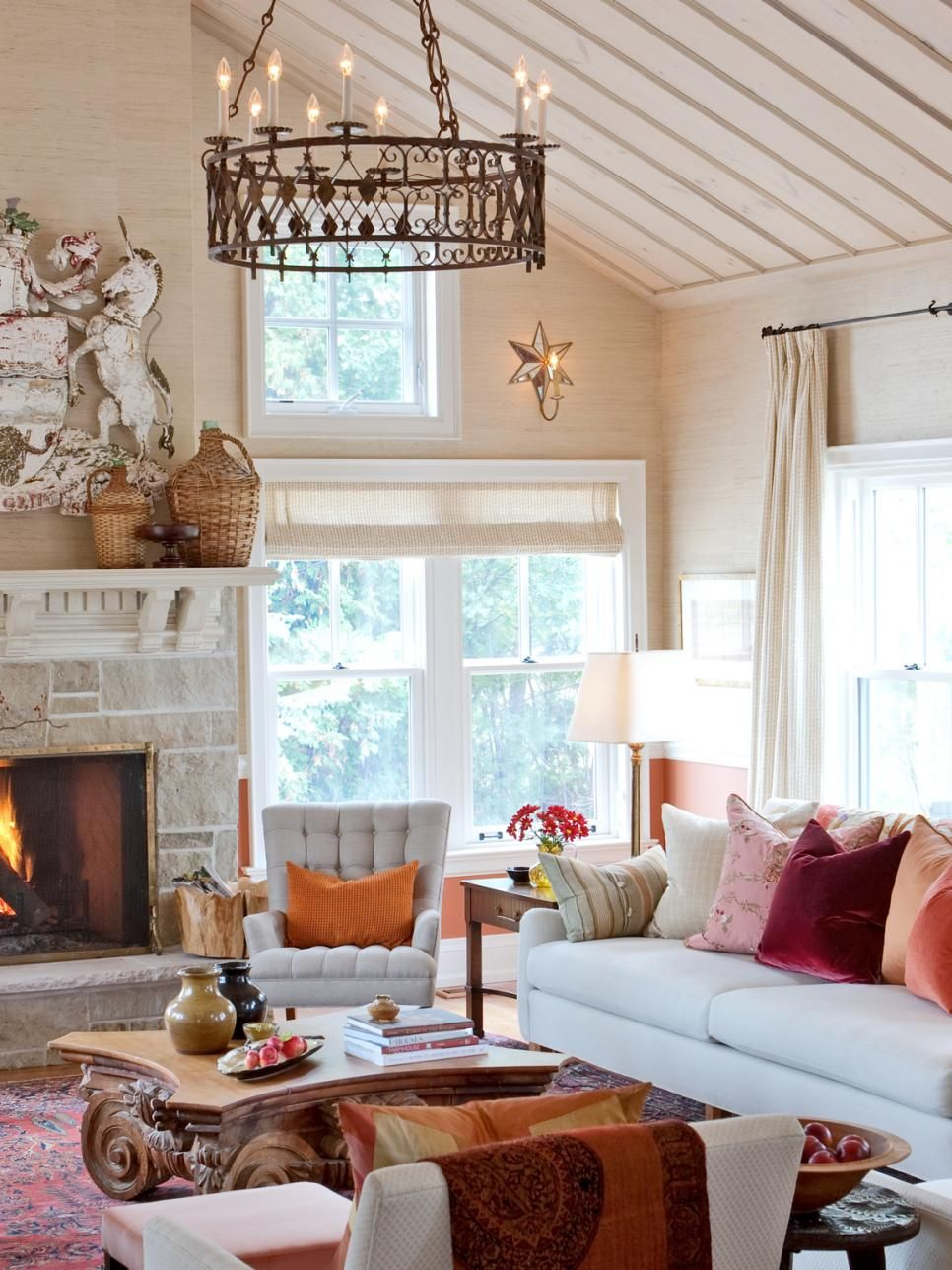 Exposed wood beams an ornate chandelier and