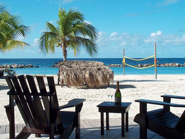 Explore The Beauty Of Caribbean: Looks Like The Two Chairs Are Just Waiting For
