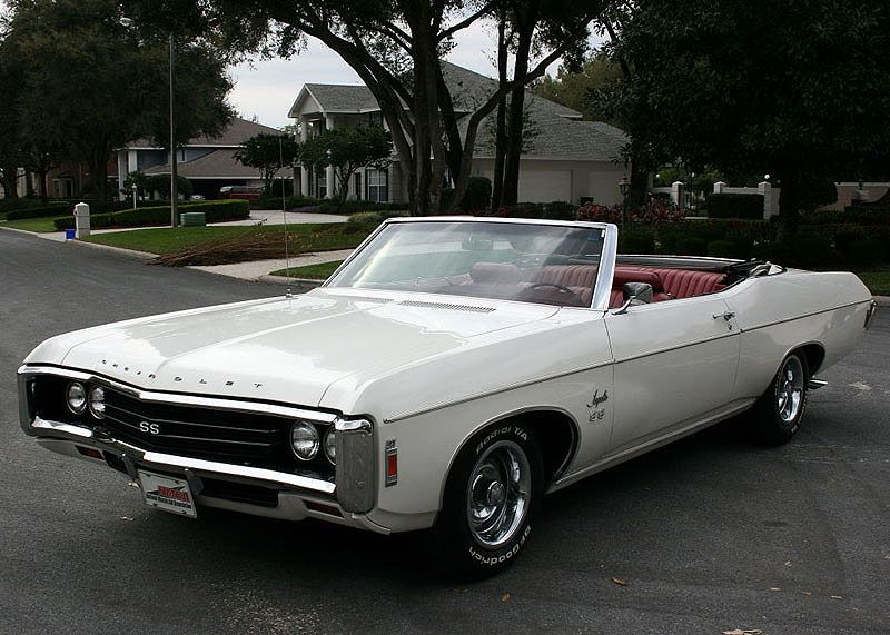 1969 Impala SS, with a factory 427.  My first car and boy, she would FLY. My boy…