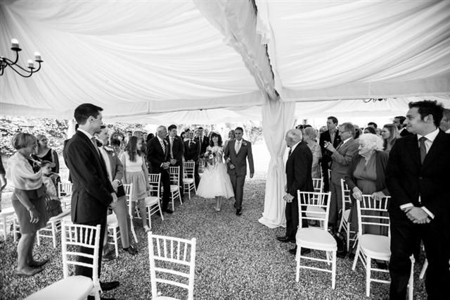 © We Do Weddings by A&J All rights reserved The groom admiring his bride, as she enters accompanied by her father in traditional style. Beautiful shot by our official photographer Matteo.