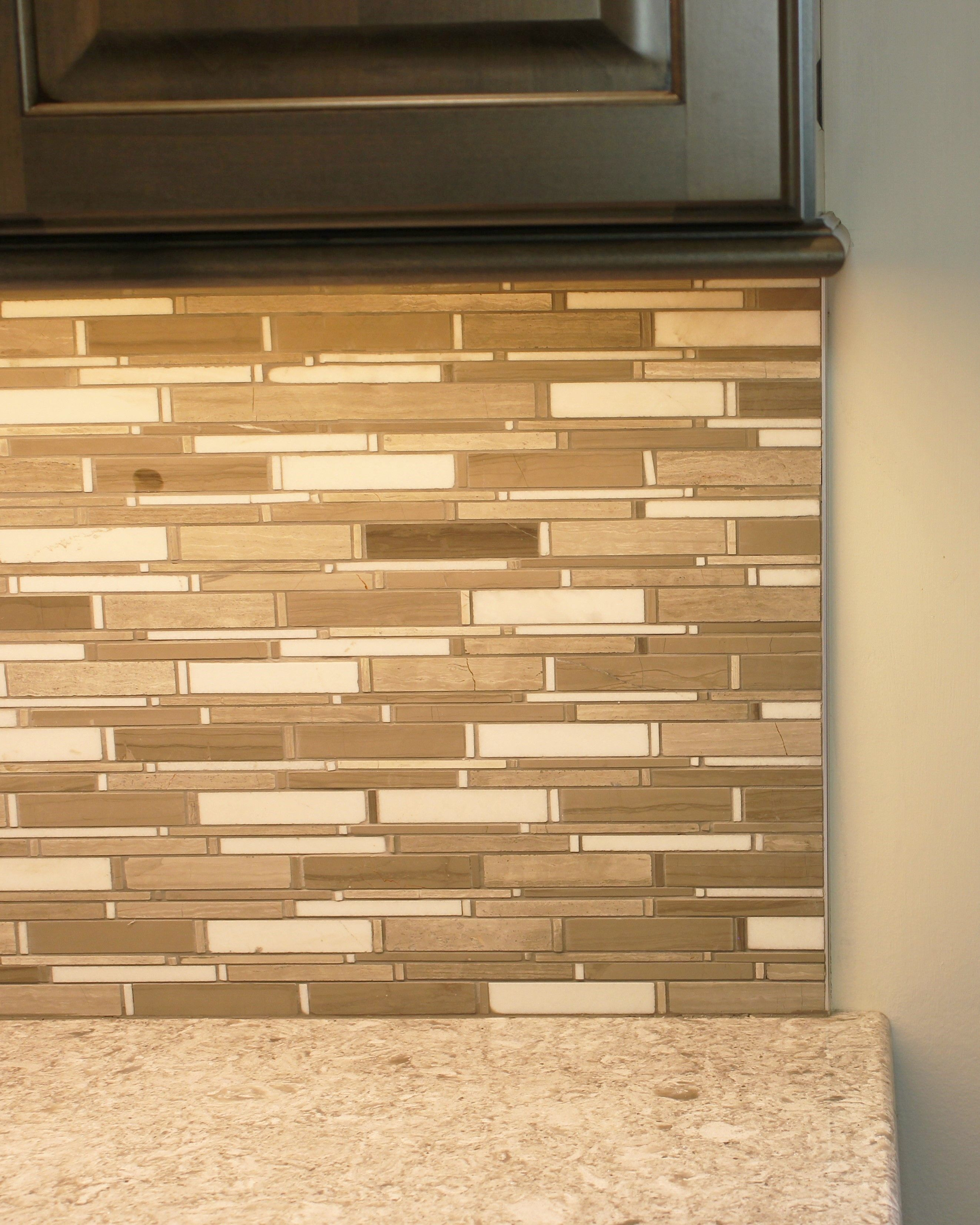 pictures of ends of glass tile backsplashes | Like many newer ...
