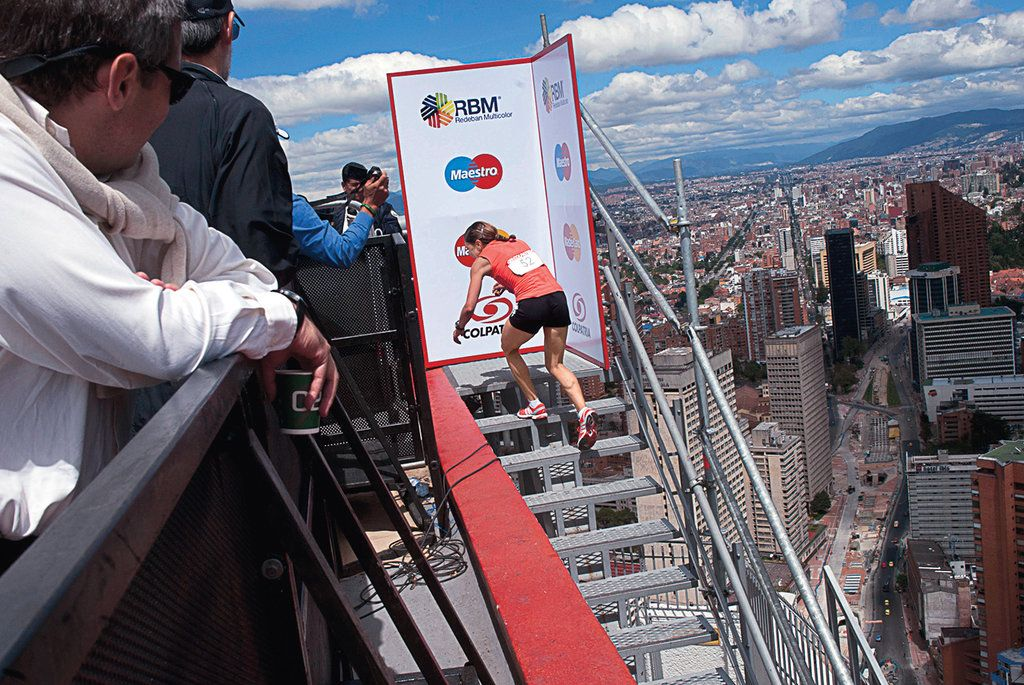 Stair climbing sport!  The race to the top of very tall buildings.  This pix from New York Times Magazine shows athlete topping 48-story building in Colombia.