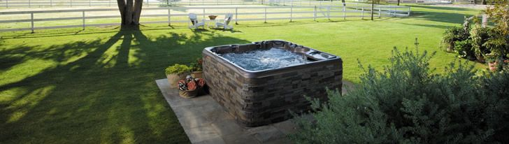 Hot Tub Ideas Backyard set your hot tub off to the side to maximize your space Backyard Hot Tub Ideas