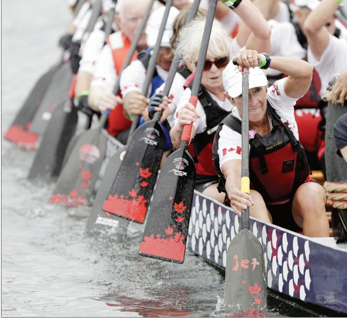 Visually impaired Pam Pospisil, Dragon Boat rower, uses boat's rock to guide her strokes.