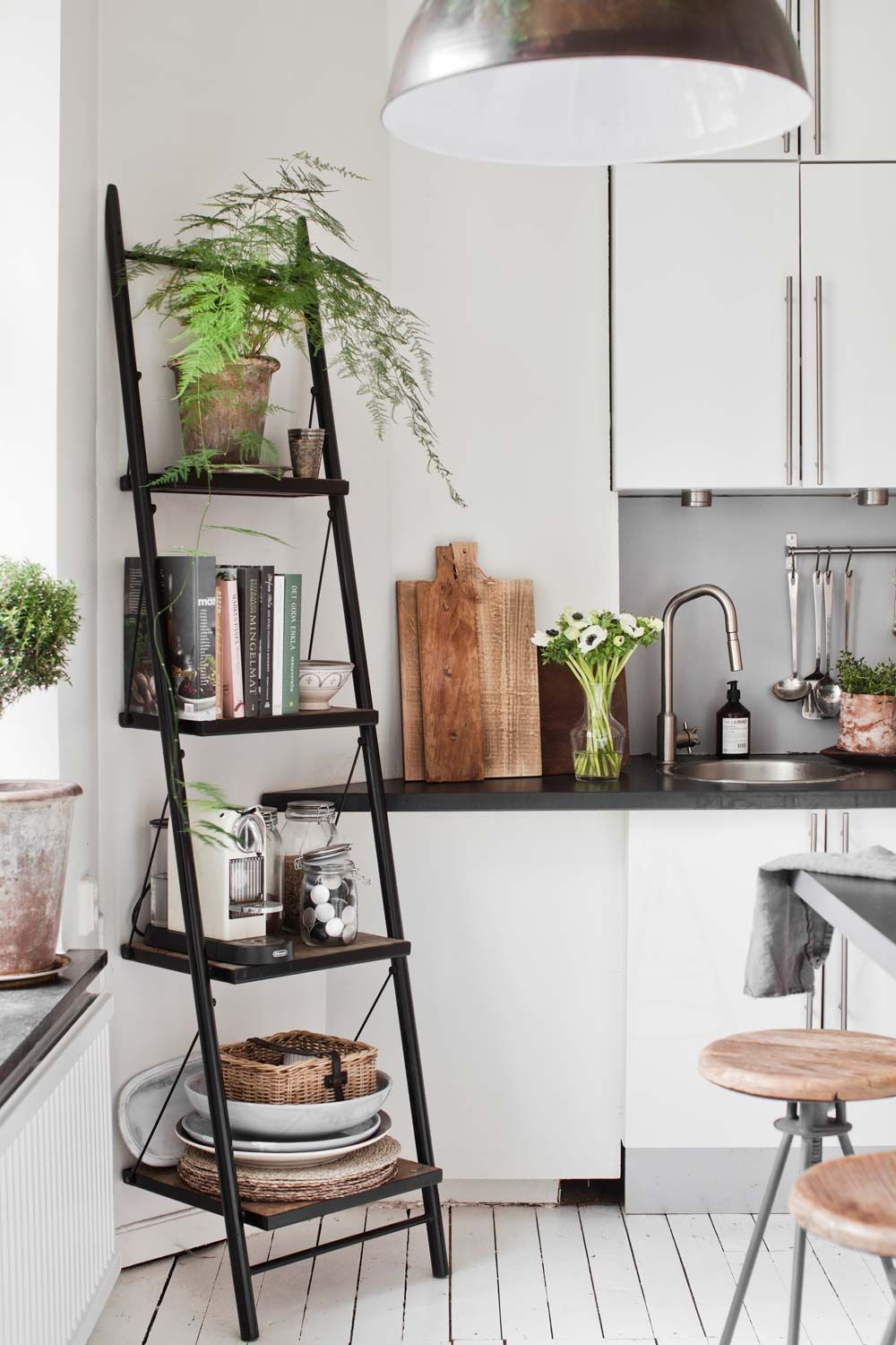 Leaning shelf in the cozy Scandinavian style kitchen of a home in Göteborg, Sweden.