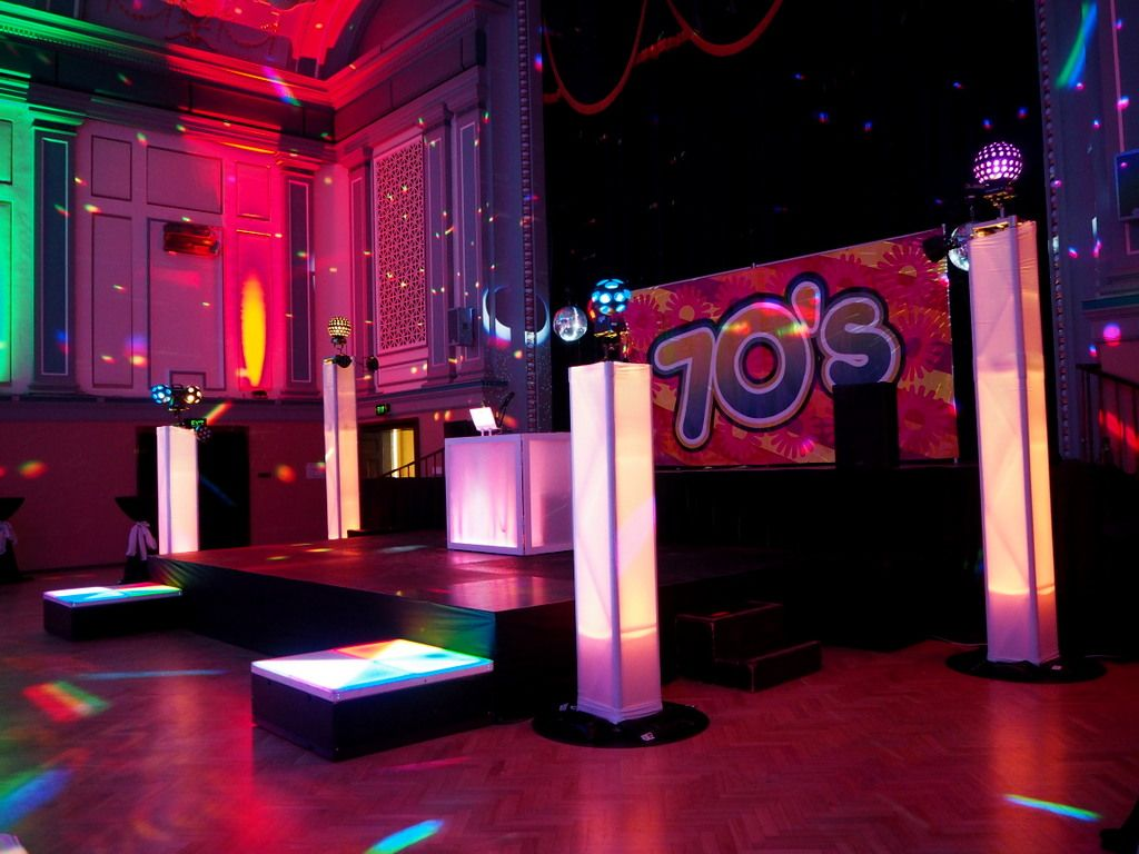 Illuminated podiums 1970s party theme decorating