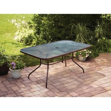 $77 Mainstays Courtyard Creations Glass Top Outdoor Dining Table, Brown  Dimensions: 61.02