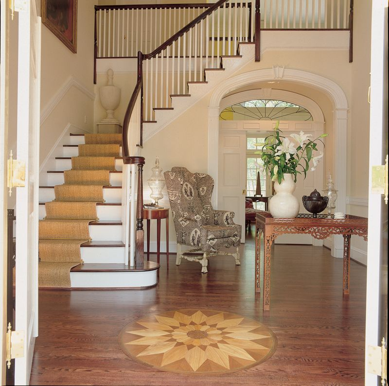 Southern plantation house entry foyer with inlaid wood for Foyer staircase ideas