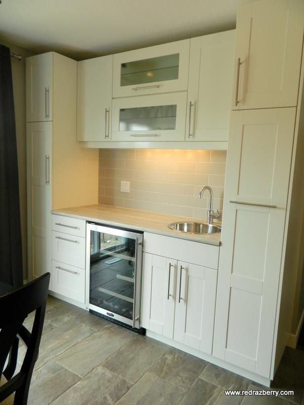 Pantry and wet bar in new build. Bar sink and faucet. Beverage/wine ...