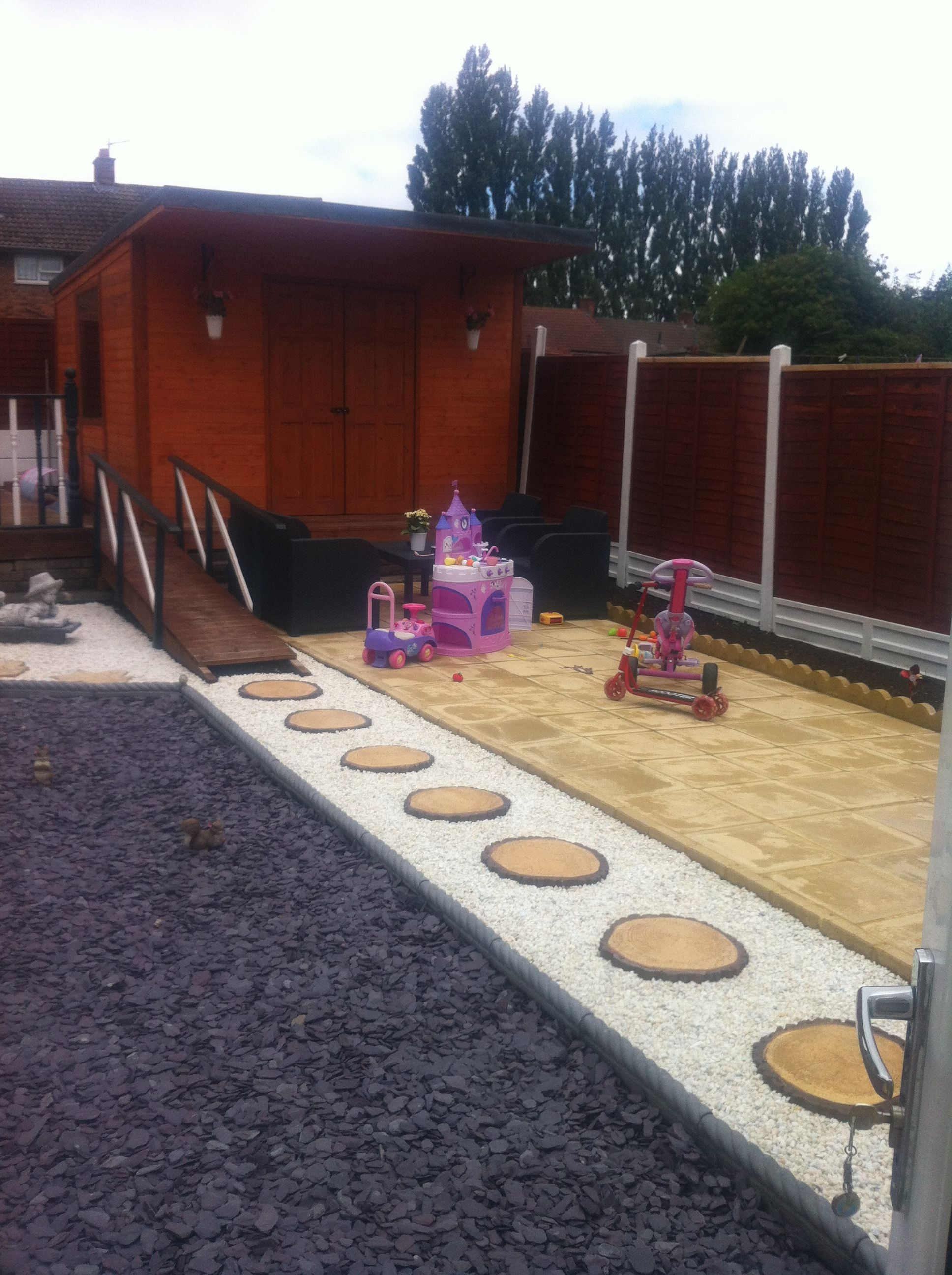 plum slate used to plement the beautiful garden pathway