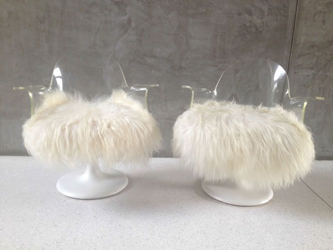 """Lucite chairs with Mongolian Sheepskin upholstery, these are the epitome of MOD. With their long barbs, they are referred to as the """"ZZ Top and or/Duck Dynasty"""" Chairs. Some scratches on the lucite---can be removed and the base is missing paint in small areas."""
