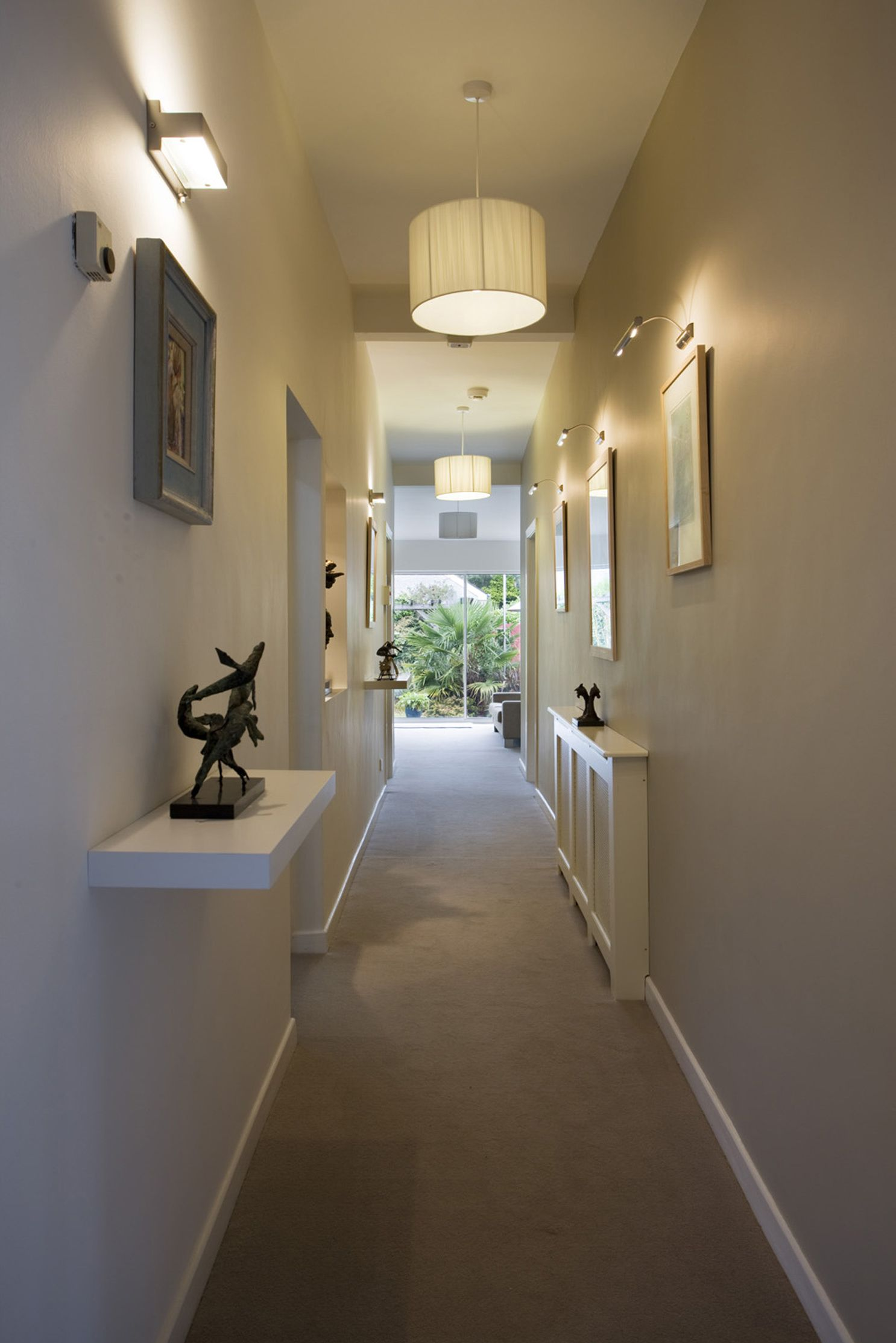 Lighting Ideas Hallway With White Drum Shade Pendant Lamps And Wall Sconces Over Framed Pictures Tips For Choosing