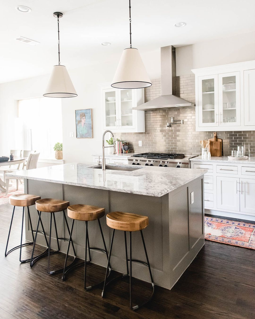 Minimal Changes Made This Builder Grade Home A Perfect Fit For Our Clients First Home Contrasting Kitchen Island Kitchen Floor Inspiration Home Decor Kitchen