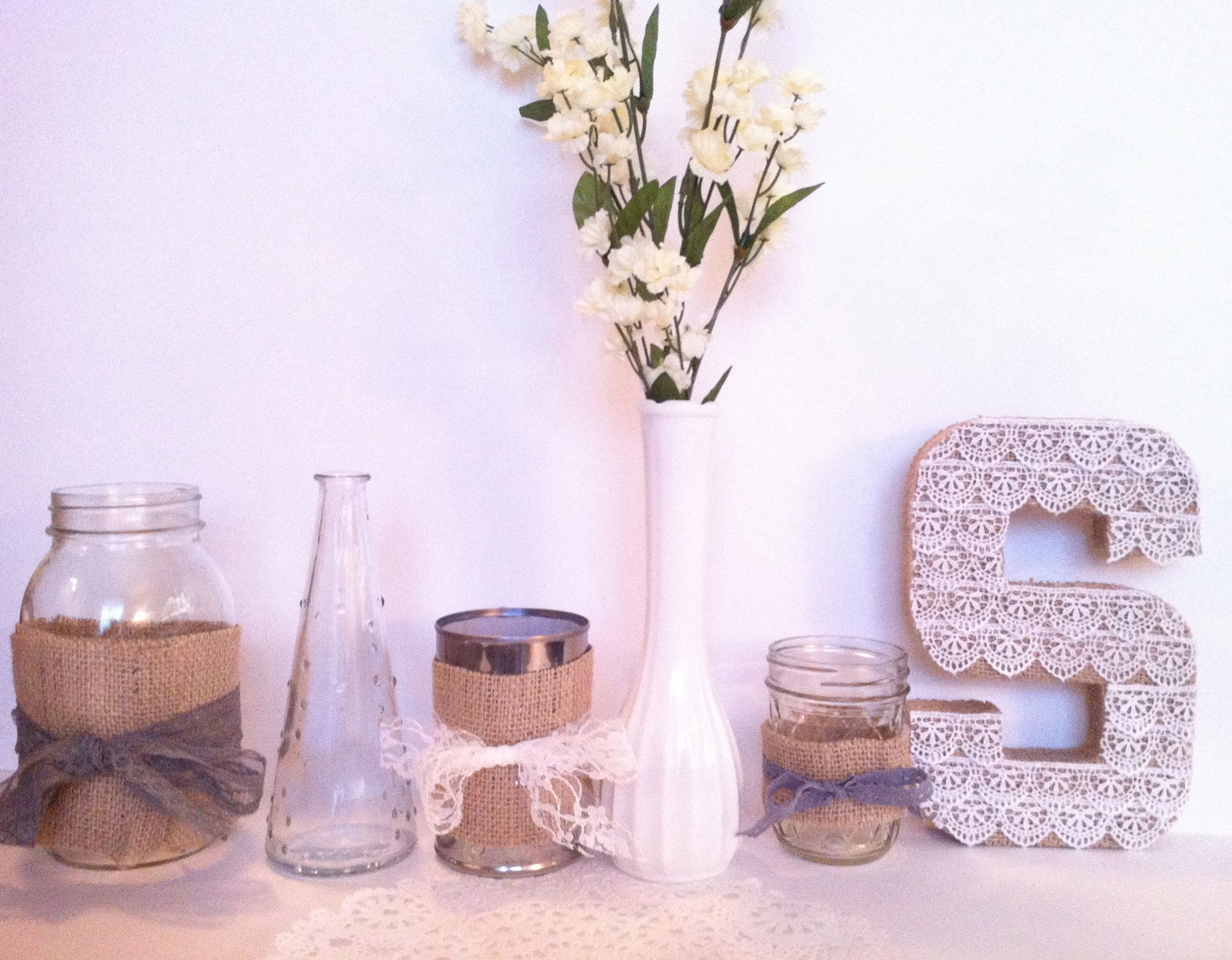 for the tables:  (1) large mason jar, 4.00  (2) ikea dotted clear vase, .79  (3) tin can, free  (4) milk glass, borrowing  (5) little mason jar, case of 12 for 8.00  (6) burlap and lace letters (for gift table?), i can make them for free, S/W or LOVE, etc.