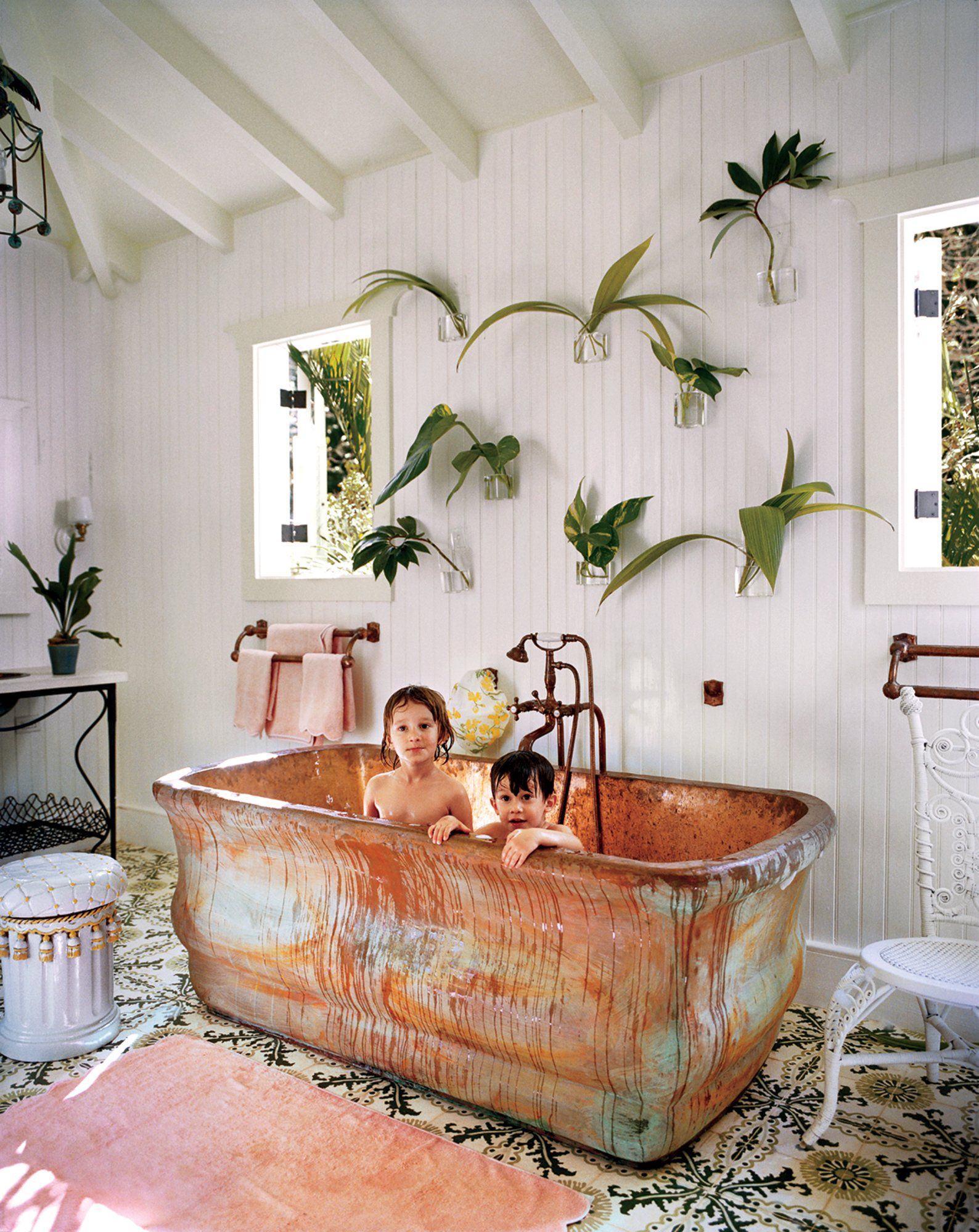 Celerie Kemble's children in her Dominican Republic oversize copper tub.