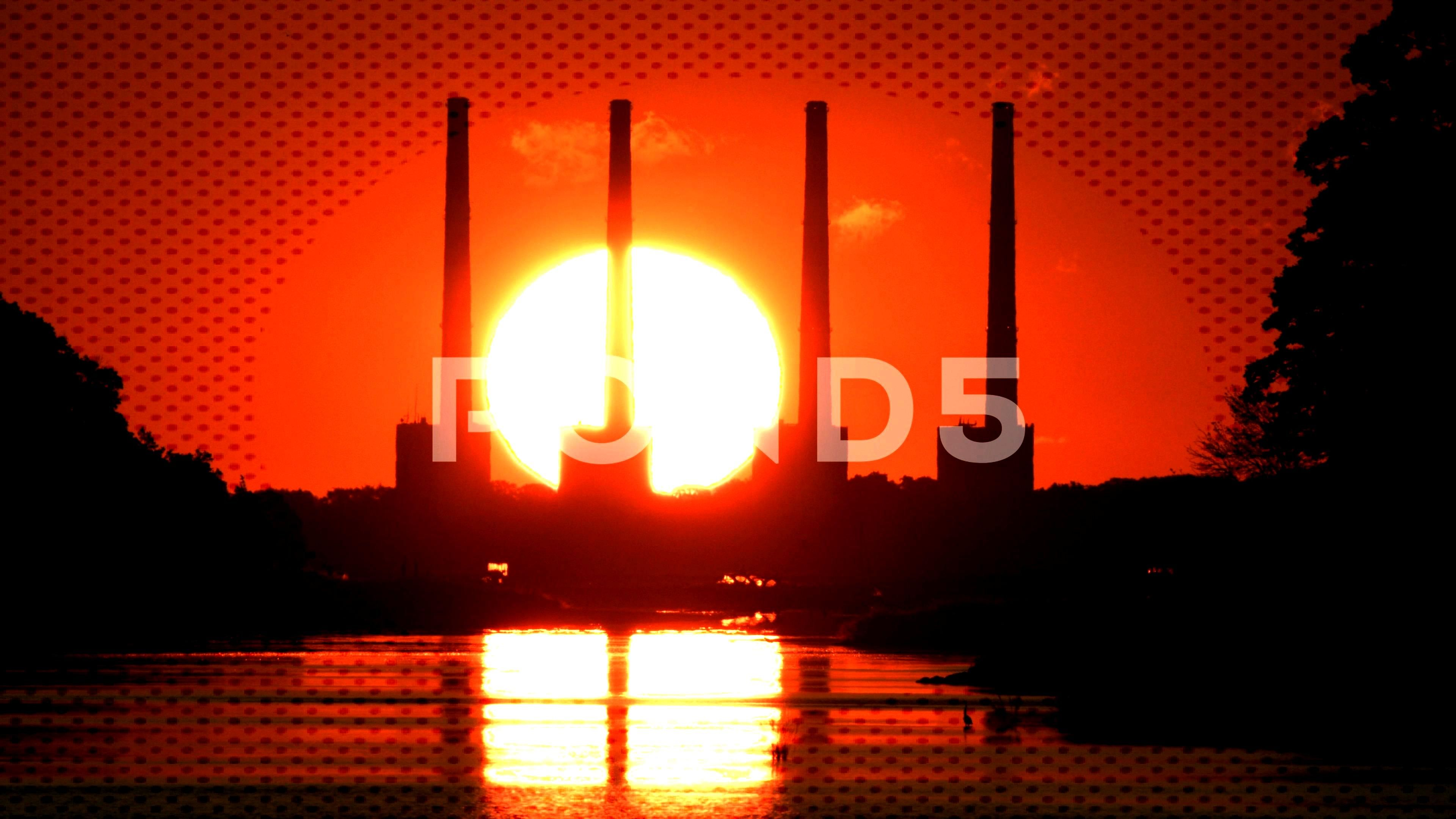 Sunrises behind smoke stacks. Stock Footage ,#smoke#Sunrises#stacks#Footage