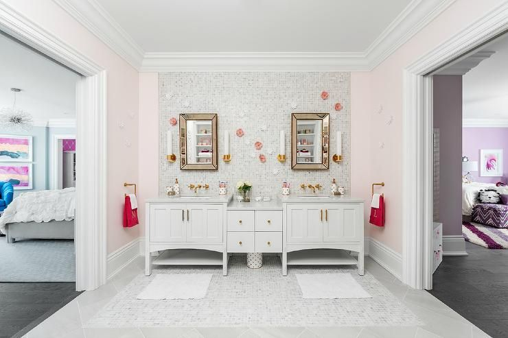 White and pink Jack and Jill girl's bathroom is ...